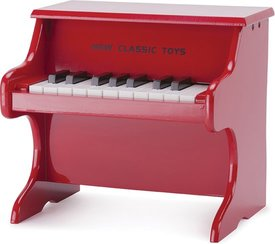 Een rode New Classic Toys piano